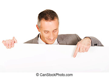 Businessman pointing on empty banner - Mature businessman...