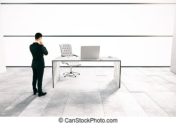 Thoughtful man in white office - Thoughtful businessman in...
