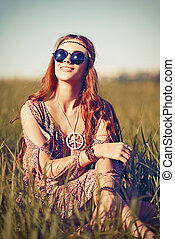 Portrait of beautiful young hippie girl in the field -...