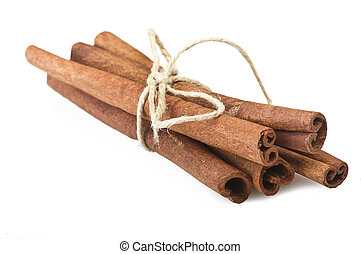 cinnamon stick spice close up on the white