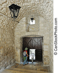 Old Jerusalem - Gate with a small door and lanterns, patio...