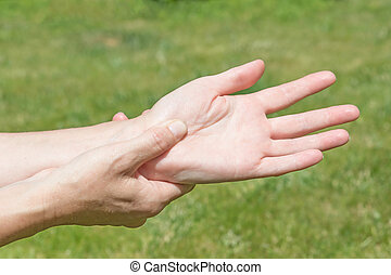 Woman showing hands pain - Female hands showing carpal...