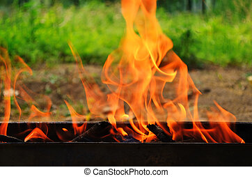 Fire on barbecue grill outdoor