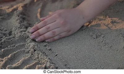 Playing with sand.
