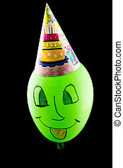 Colorful funny balloon on black background - The colorful...