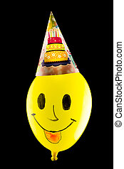 Colorful funny balloon on black background