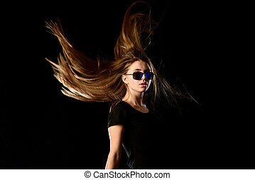 Teenage girl with streaming hair and sunglasses