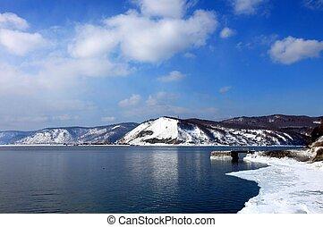 Frozen Lake Baikal in spring. Day. Nobody.