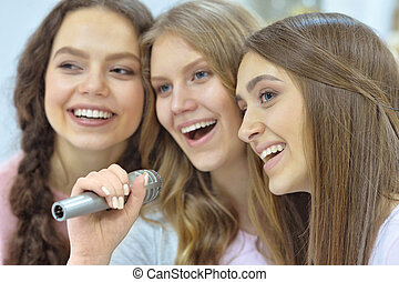 Young women with microphone - Portrait of a young women with...