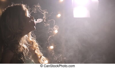 Woman smoke e cigarette, exhale thick flow, a lot of vapor fill whole frame, float smoothly