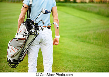 Golfer walking with golf bags - Waiting for his turn to play...