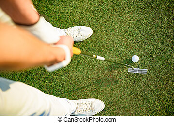 Golf player ready to putting ball - Driving it to the green....