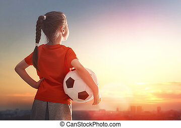 Child plays football. - Cute little child dreams of becoming...