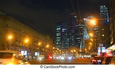 Moscow street traffic and 'Moscow city' business district skyscrapers at night