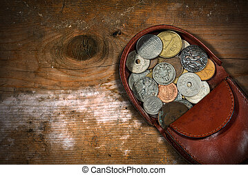 Leather Purse with Old Coins - Macro photography of a brown...
