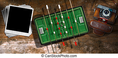 Foosball with Old Camera and Photo Frames - Top view of a...