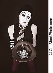 Mime with hat in hand begging closeup
