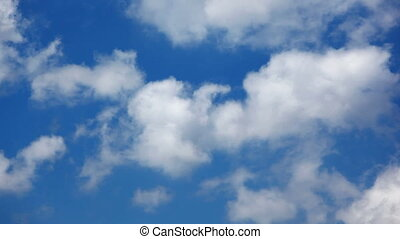 Heavy cumulus clouds passing accelerated throw blue sky...