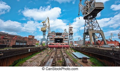 Construction of the ship in shipyard timelapse with cranes....