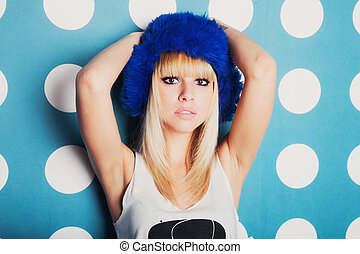 Young woman dressed in blue winter hat - Studio portrait of...