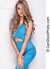 Blonde young girl in blue dress - Blonde beautiful young...