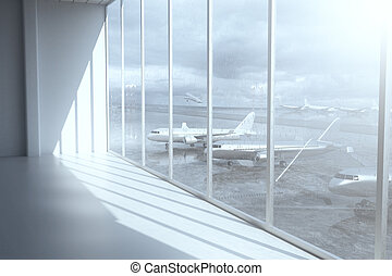 Airport terminal interior with daylight and windows with a...