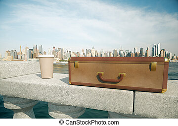 Coffee cup and closed suitcase - Clouseup of closed suitcase...