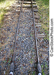 Step on old narrow-gauge railways - Feet stands on old...