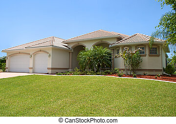 generic florida home - a generic florida home sits on a...