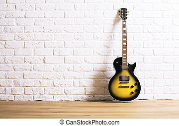 Electric guitar in interior - Black and yellow electric...