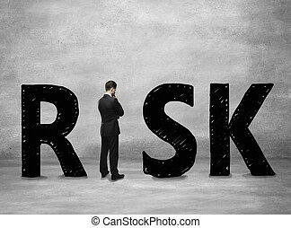 Business risk concept with thoughtful businessman standing...