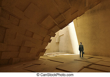 Businessman in cave-like interior - Thoughtful businessman...