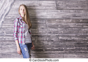 Woman against wooden wall - Thoughtful casually dressed...
