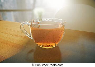 Tea on wooden desktop - Wooden desktop with transparent tea...