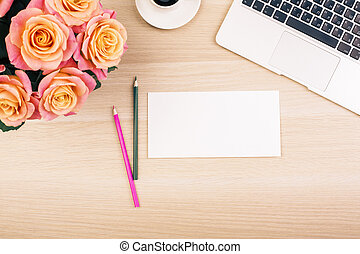 Desktop with flowers and paper - Top view of creative...