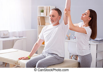 Modern rehabilitation physiotherapy - Therapy. Cheerful and...
