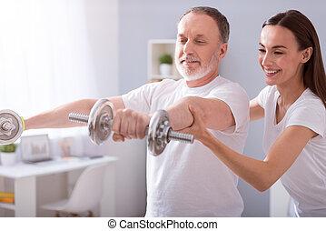 Modern rehabilitation physiotherapy - Using dumbbells....
