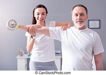 Modern rehabilitation physiotherapy - Rehab praxis. Smiling...