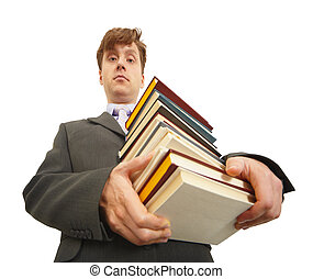 Waggish man holding pile of textbooks - Waggish young man...