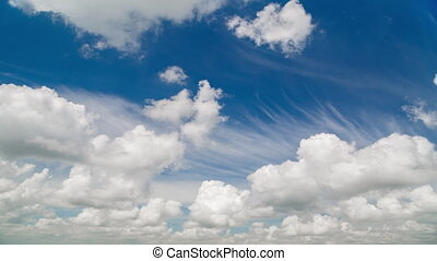 Time lapse of movement fluffy clouds in the bright blue sky...