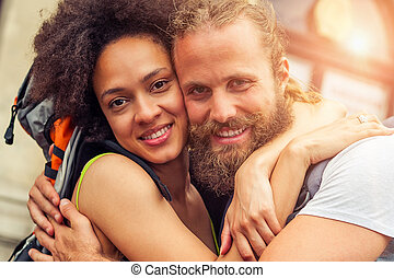 Closeup of beautiful couple of tourists in love enjoy their...