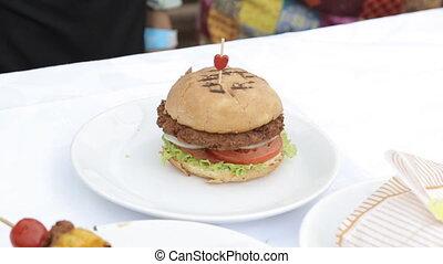 Homemade veggie burger served on wooden table - Homemade...