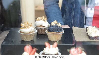 decorated cupcakes with descriptive sign on each.