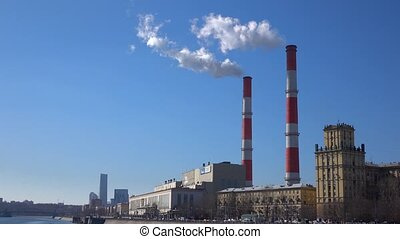 Heat electric plant and smoke from smoke stacks against blue...