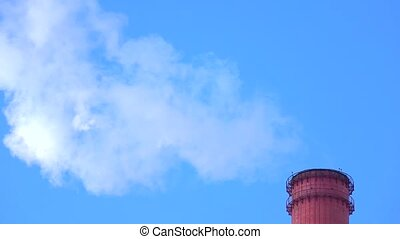 Smoking red smoke stack top against sunny blue sky. 4K...