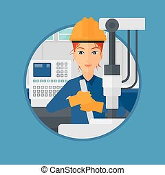 Woman working on industrial drilling machine Woman using...
