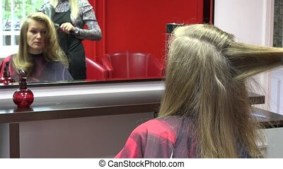 Worried single woman at personal stylist salon make haircut...