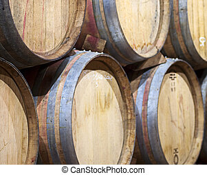 Barrels - Closeup of wine barrels piled in a cellar