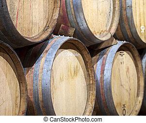 Barrels - Closeup of wine barrels piled in a cellar