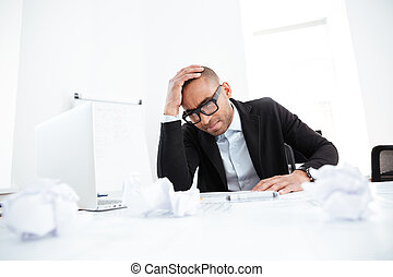 Stressed business man with work problems in the office -...